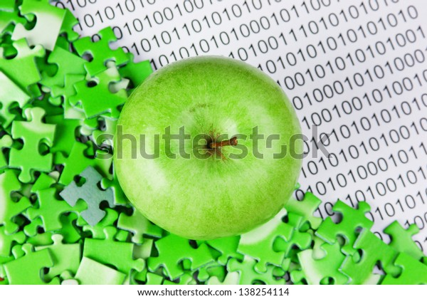 green apple and puzzles on a binary code