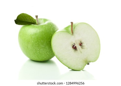 Green apple pyramid. Ripe green apples isolated on white background