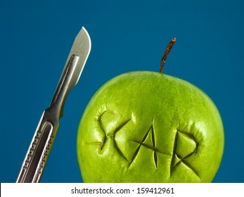 Green apple with Scar and scalpel. Failure plastic surgery. Removal of scars. Recovery after surgery. Unprofessional surgeon. Medical concept.