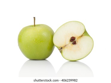 green apple and slice isolated on a white background