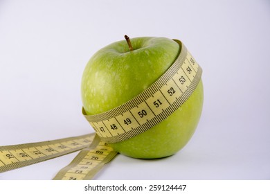 green apple with tape line