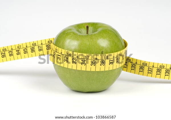 Green apple with tape measure