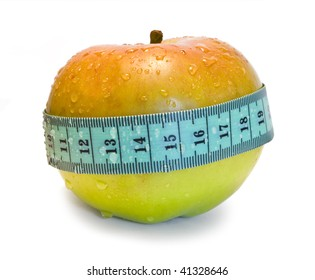 The green apple with water drops is measured