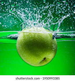 Green Apple Water Splashes Freeze Motion Green Background
