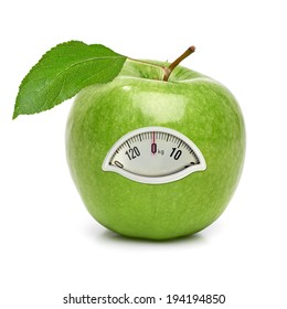 Green apple with weight scale on white background