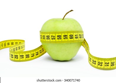 Green apple wrapped the measuring tape on a white background