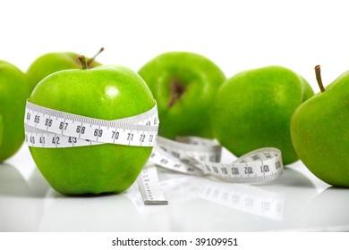 Green apples measured  the meter, sports apples
