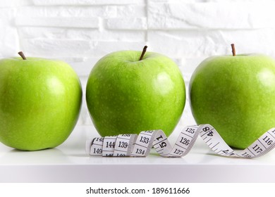 Green Apples with Measuring Tape