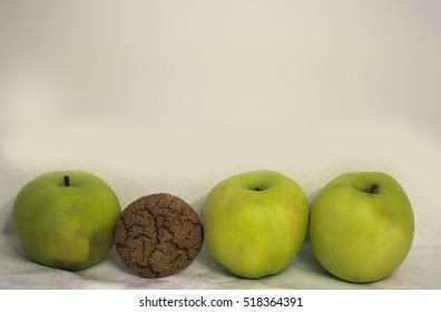 Green apples and oatmeal cookies. healthy eating and diet.horizontal view
