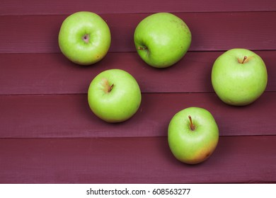 Green apples on old wood table.