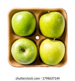 Green apples on pulp paper food tray isolated on white. Top view.