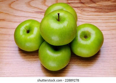Green apples on a wood background