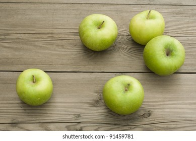 green apples on wooden table