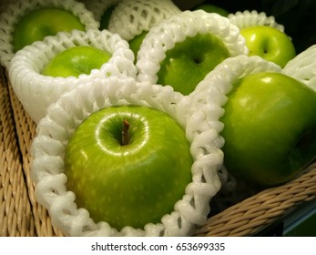 Green apples with packing foam net