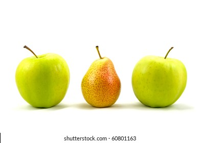 green apples with the pear standing out from the crowd  over a white background