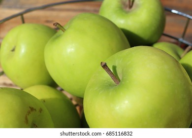 Green Apples in a Wire Dish