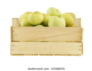 Green apples in wooden box isolated on white