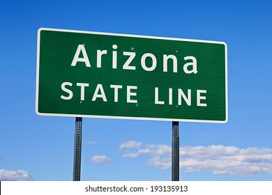 A Green Arizona State Line Road Sign