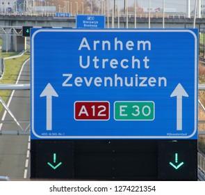 Green arrow above the driving lane indicating that its open on motorway A12 E30 heading Arnhem, utrecht and Zevenhuizen