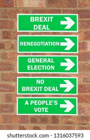Green arrowed roadsigns with options for Brexit negotiations including Renegotiation, a Brexit deal, a no Brexit deal, a General Election or a People's Vote.