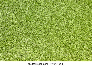 Green artificial grass background and texture