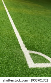 green artificial grass football field with white line corner sport background