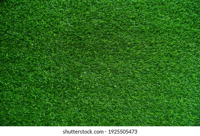 Green artificial grass on natural background