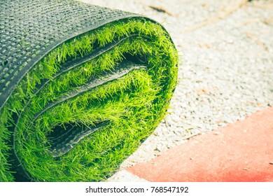 Green artificial grass roll.