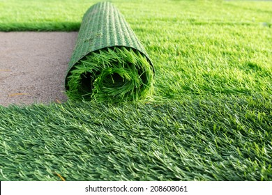 Green artificial grass soccer field