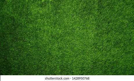 Green Artificial Grass Texture Background Close-up