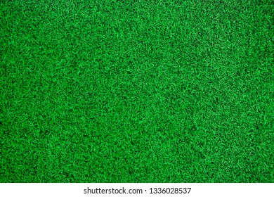 Green artificial grass top view background.