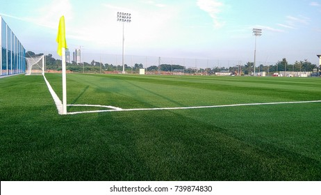 green artificial soccer field with yellow corner flag
