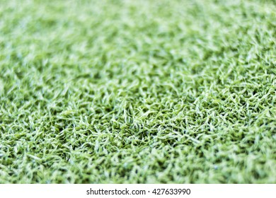 Green artificial turf close up background texture