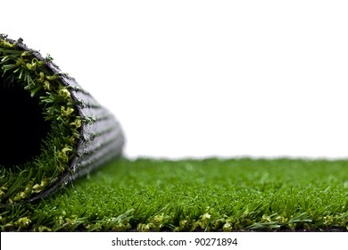 Green artificial turf rolled