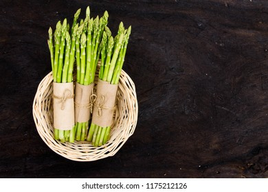 Green asparagus in a basket Fresh asparagus