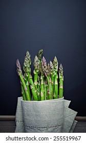 Green Asparagus. Healthy food ingredients. Flatlay. Black background. Copy space
