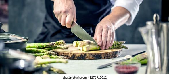 Green asparagus kept in men's Chef cook hands