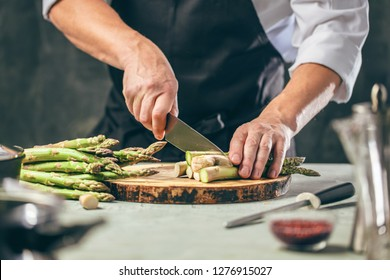 Green asparagus kept in men's Chef cook hands