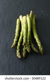 green asparagus on stone