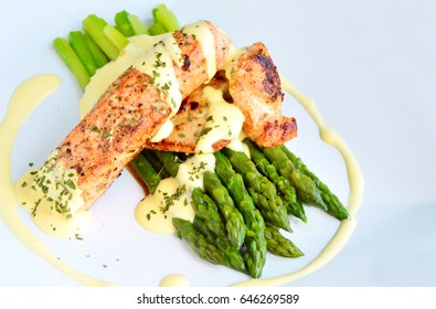 Green Asparagus with salmon and hollandaise sauce (German name is Spargel mit Lachs und Sauce Hollandaise) Menu for spring season.