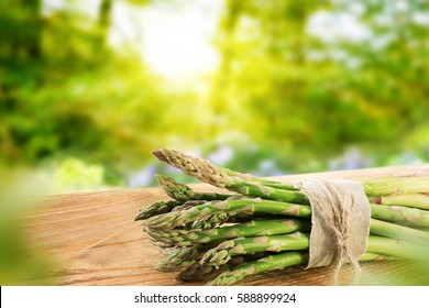 Green asparagus in spring on a wooden board