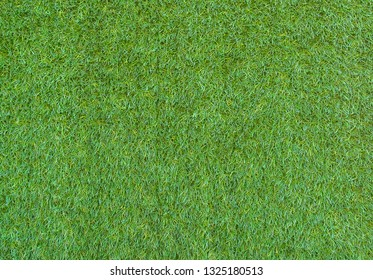 Green astroturf. Artificial grass. Background. Selective focus