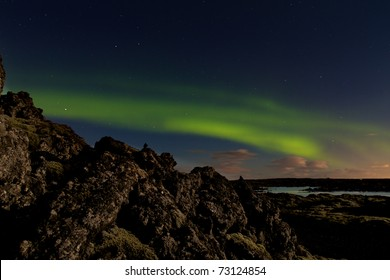 Green aurora or northern lights at the Blue Lagoon spa in Iceland