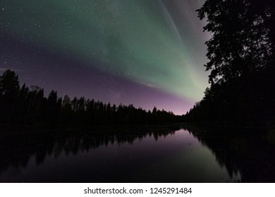 Green auroras on Sanginjoki river in Oulu, Finland