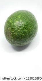 green avocado fruit closeup isolated on white background studio