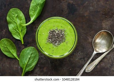 Green avocado, spinach and grape smoothie with chia seeds - healthy breakfast idea.