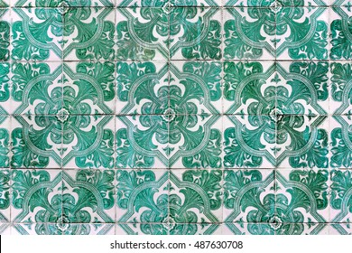 green azulejos with floral paintings - hand made tiles from Lisbon, Portugal
