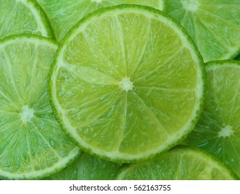Green background with citrus-fruit of lime slices.