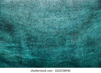 Green background of colored gauze