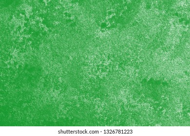 Green background. Detail of dirty wall.